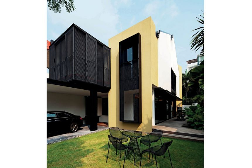 (Above) Mustard hues contrast against white to create a distinction between the newly built extensions and original architecture of the house.