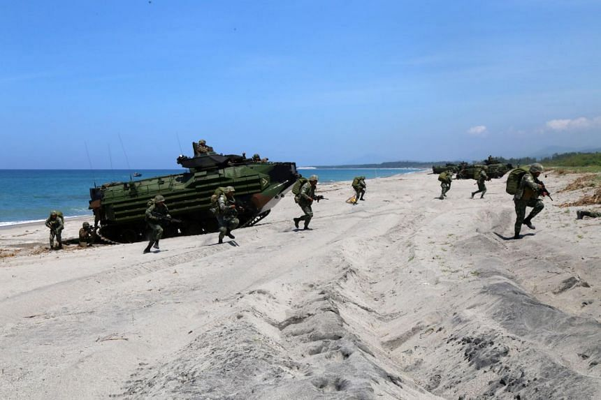 Filipino soldiers practise assaulting a beach after disembarking from a US Amphibious Armored Vehicle as part of the ongoing joint US-Philippine bilateral military exercises in San Antonio, the Philippines, on Oct 6, 2018.