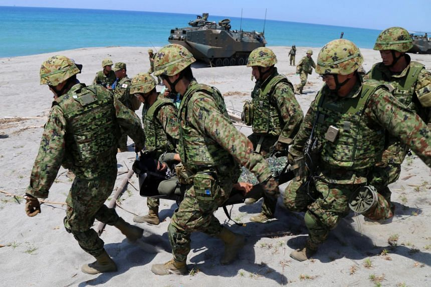Japanese troops participating in a mock humanitarian assistance and disaster relief operation as part of the ongoing joint US-Philippine bilateral military exercises in San Antonio, the Philippines, on Oct 6, 2018.