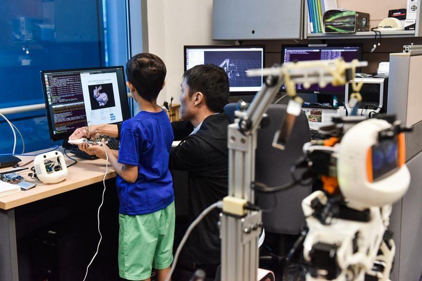 Zahaan Tambawala learning about robotic sensing.