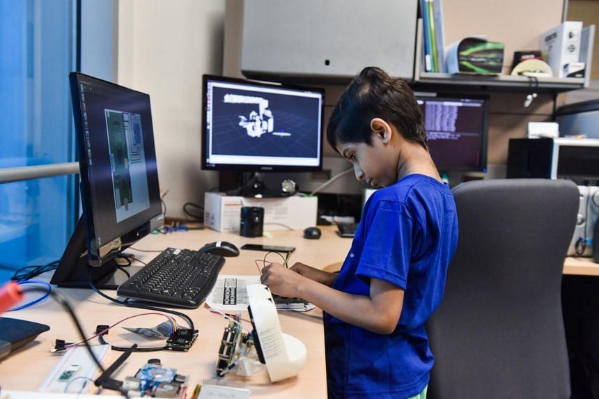 Zahaan Tambawala wiring sensors to a Raspberry Pi.