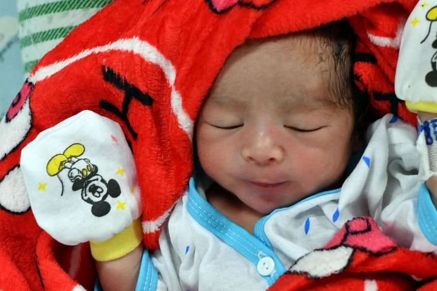 A newborn baby onboard a floating hospital docked in Palu port on Oct 6, 2018.