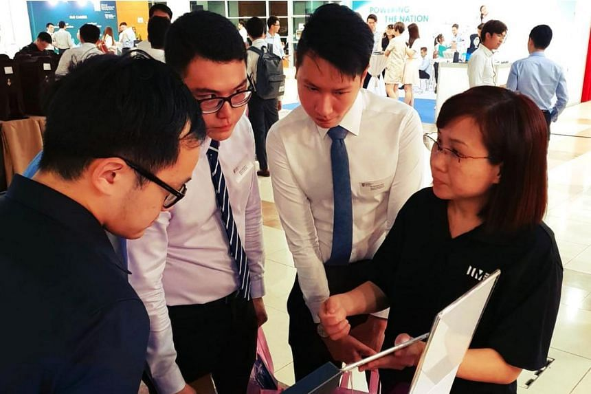Nanyang Technological University students at the Infocomm Media Development Authority booth during an invite-only career fair called NTUtopia in September 2018.