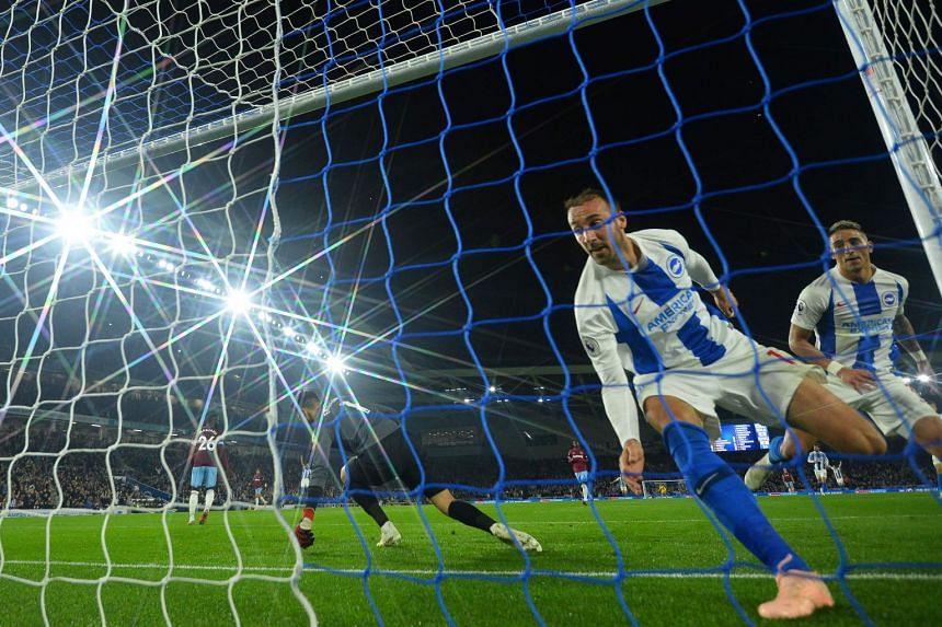 Murray (right) celebrates scoring for Brighton past West Ham goalkeeper Lukasz Fabianski.