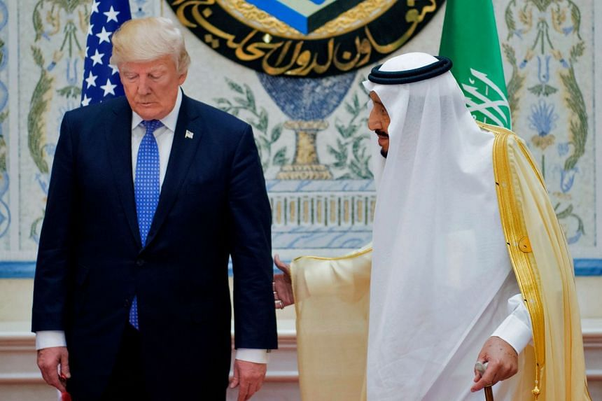 Trump (left) and King Salman bin Abdulaziz al-Saud arrive for a Gulf Cooperation Council meeting in 2017..