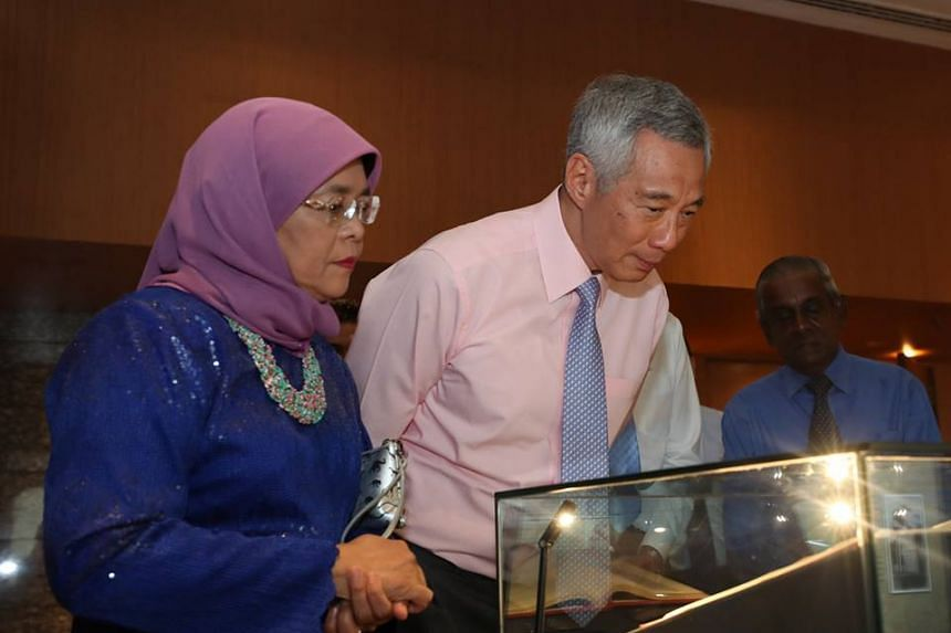 The clutch sported by Madam Halimah Yacob was designed by 21-year-old Pathlight student See Toh Sheng Jie, who is known for his talent in drawing dinosaurs.