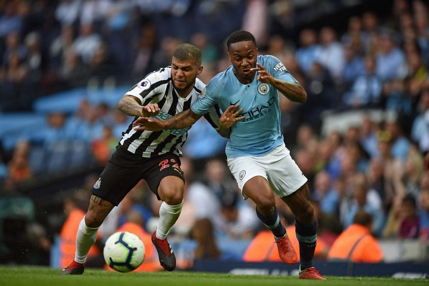 Newcastle United defender DeAndre Yedlin (left) vies with Manchester City's English midfielder Raheem Sterling during the English Premier League football match between Manchester City and Newcastle United at the Etihad Stadium in Manchester, on Sept