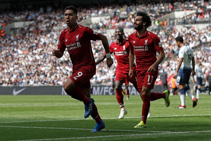 Liverpool's Roberto Firmino (left) celebrates with teammates Mohamed Salah and Naby Keita after scoring their second goal during their English Premier League football match against Tottenham Hotspur at Wembley Stadium in London, on Sept 15, 2018.