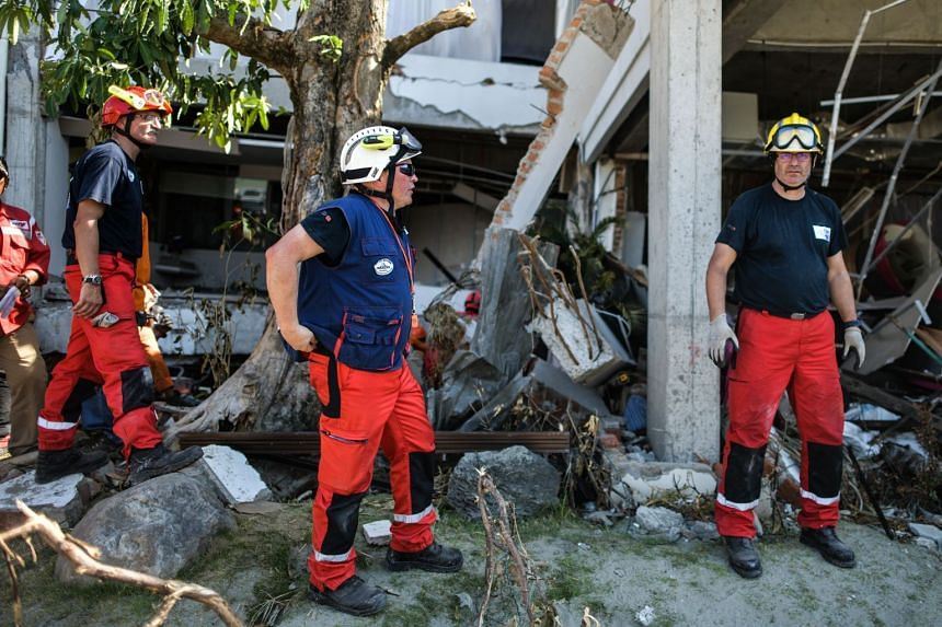French rescuers preparing to enter the badly damaged Mercure hotel for search and rescue operations in Palu in Indonesia's Central Sulawesi on Oct 4, 2018.