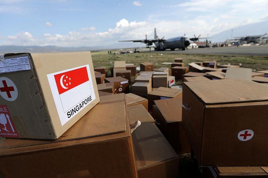 Indonesia military personnel unload logistic aid from a Singapore military plane at Mutiara Al Jufri Airport in Palu, central Sulawesi, Indonesia, on Oct 5, 2018.