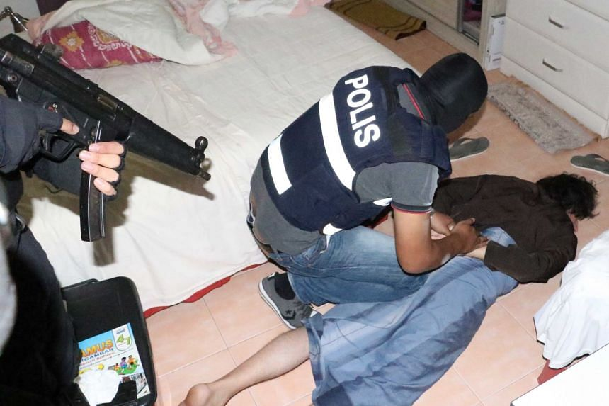 Eight men with suspected terrorist links have been rounded up and detained in Malaysia for suspected activities that threatened national security.