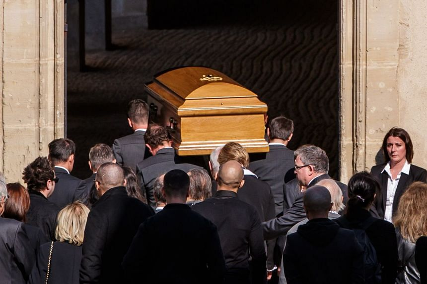 Pallbearers carry the coffin of late French-Armenian singer Charles Aznavour.