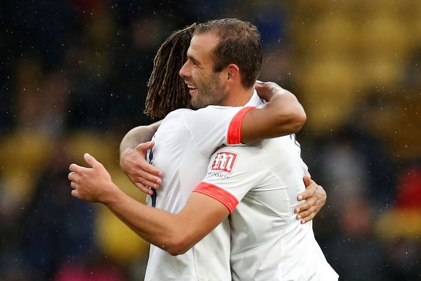 Bournemouth's Nathan Ake celebrates after the match with Steve Cook.
