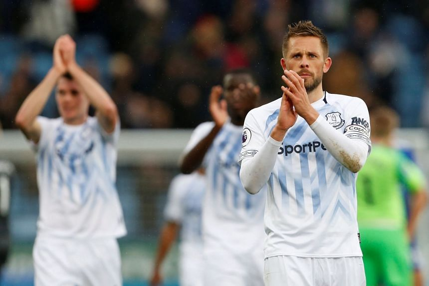 Everton's Gylfi Sigurdsson applauds the fans after the match.