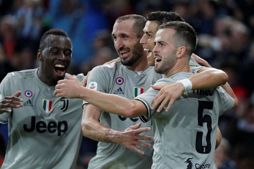 Juventus' Cristiano Ronaldo celebrates scoring their second goal with team mates.
