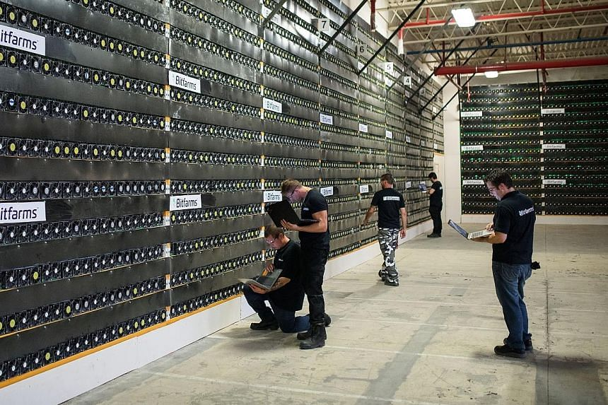 Technicians monitor cryptocurrency mining rigs at a facility in Canada. Acquiring the technology may eventually lead to well-paid and satisfying jobs.