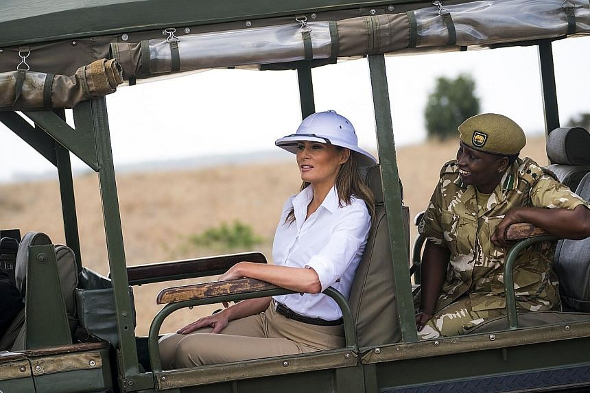 "United States First Lady Melania Trump on a safari at Nairobi National Park in Kenya last Friday, wearing a white pith helmet - a common symbol of European colonial rule. Earlier this year, she wore an ""I really don't care. Do U?"" jacket on the way t"