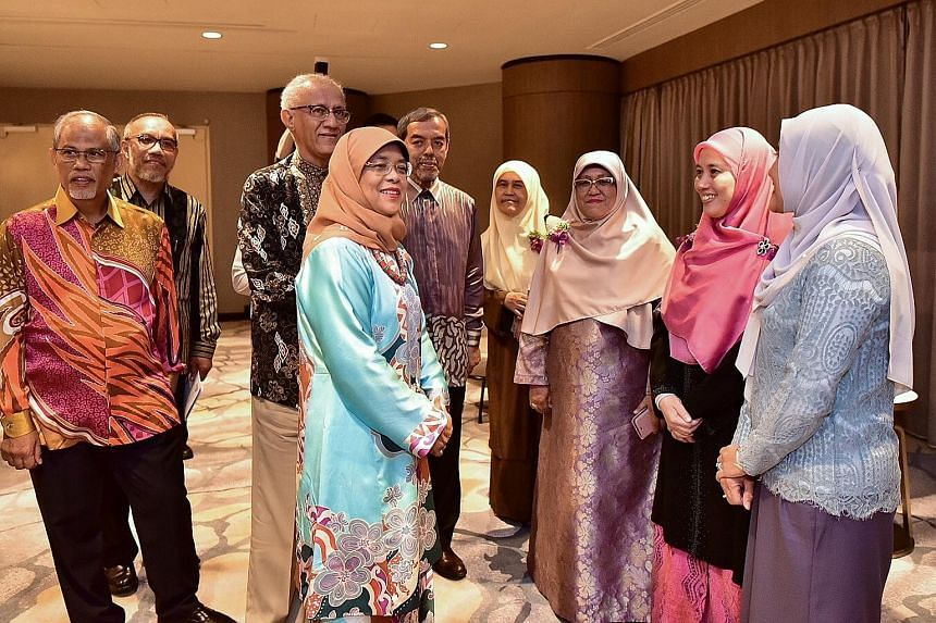 (From left) Minister-in-charge of Muslim Affairs Masagos Zulkifli, Muis deputy chief executive Albakri Ahmad, President Halimah Yacob's husband Mohamed Abdullah Alhabshee, Madam Halimah and Muis chief executive Abdul Razak Maricar, with award recipie