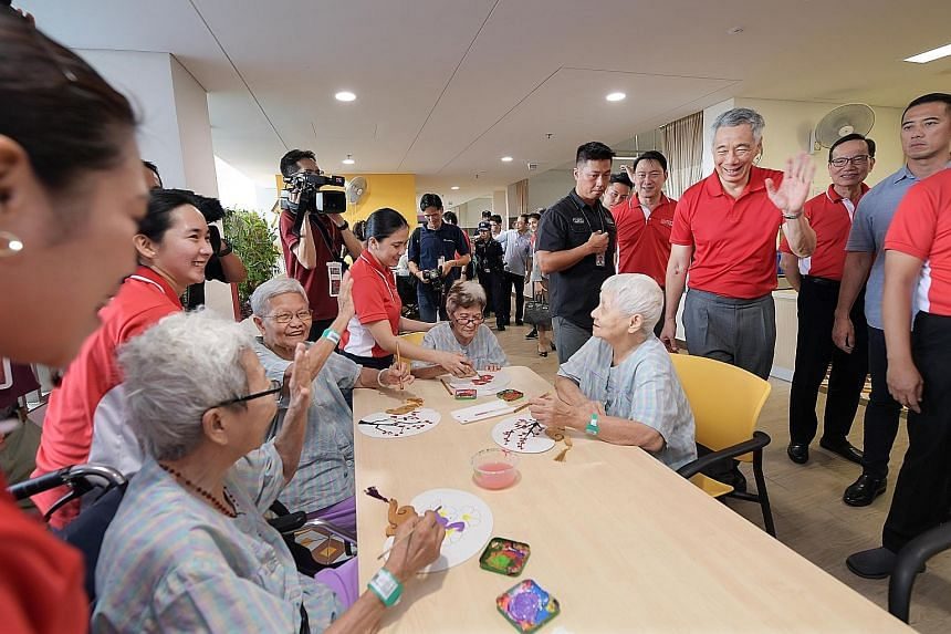 Prime Minister Lee Hsien Loong greeting seniors at the Kwong Wai Shiu Hospital. The redeveloped 600-bed nursing home in Serangoon offers inpatient and outpatient services, day rehabilitation, day care, centre-based nursing services and a training cen