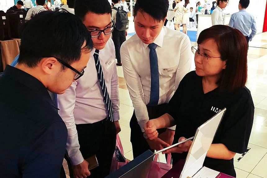 NTU students at the Infocomm Media Development Authority booth during NTUtopia, an invite-only career fair. One undergraduate said organisers had checked resumes and GPAs at the door.