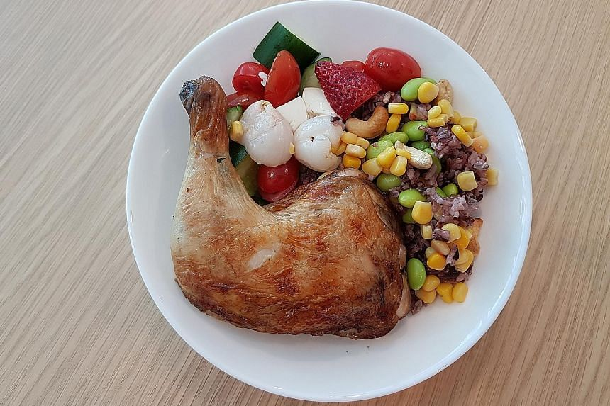 The Totally Nutrition Power With Chicken rice bowl includes a roast chicken leg, organic black, brown and red rice, fruit and vegetables.