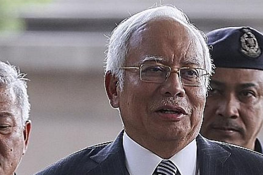 Former Malaysian prime minister Najib Razak at the Kuala Lumpur High Court in August. The claims in the US Department of Justice lawsuit have become grounds for the new government to pursue charges of criminal breach of trust against Najib and his as