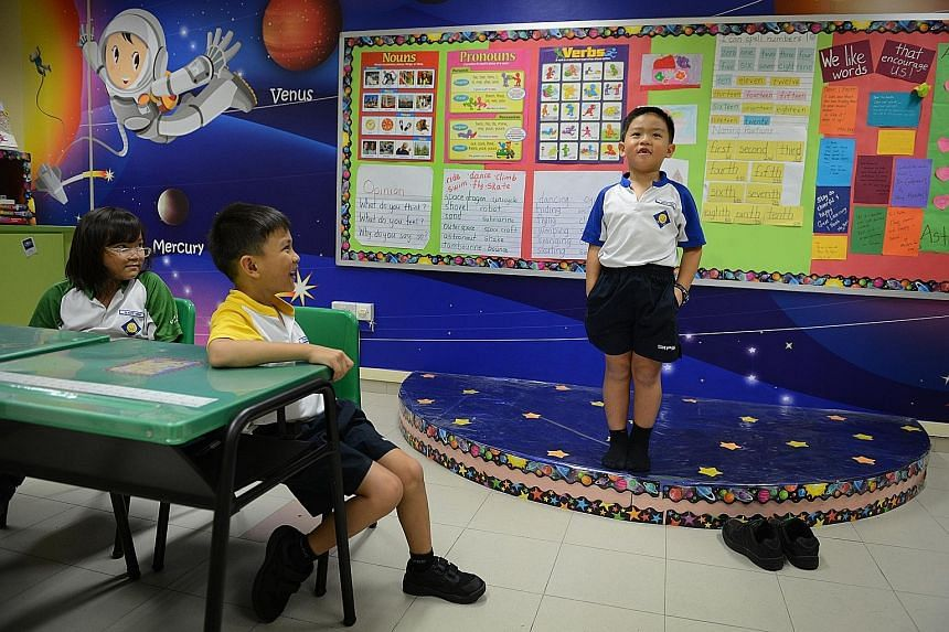 Above: Seng Kang Primary School has performing arts as its niche programme and has a stage in every classroom as a teaching aid. Left: Mr Wong Siew Hoong, director-general of education at the Ministry of Education), says part of its work is finding i