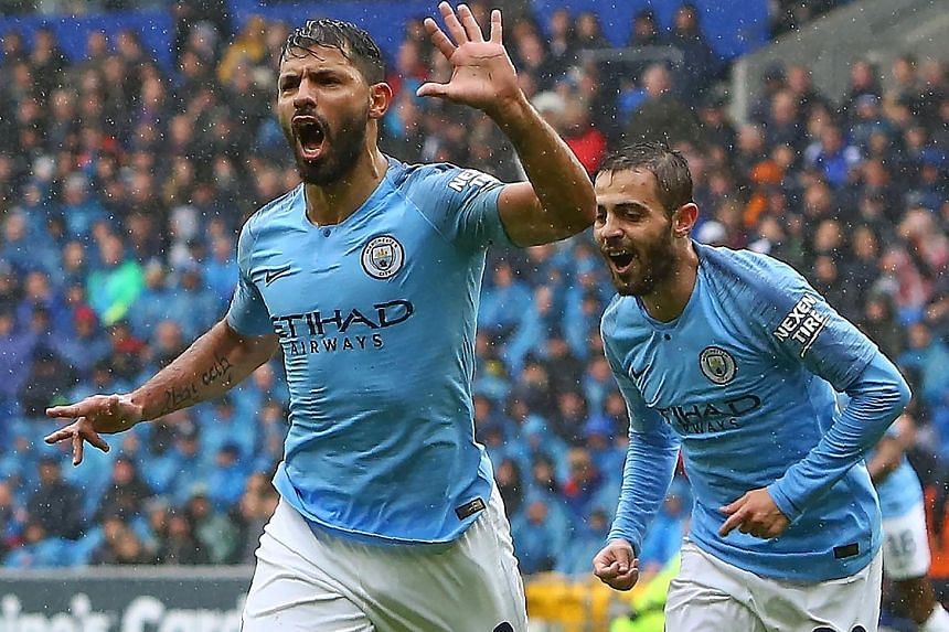 Man City striker Sergio Aguero celebrating with midfielder Bernardo Silva after scoring the opening goal away to Cardiff in the Premier League last month. They won 5-0 - their biggest win this season, alongside the 6-1 home demolition of Huddersfield