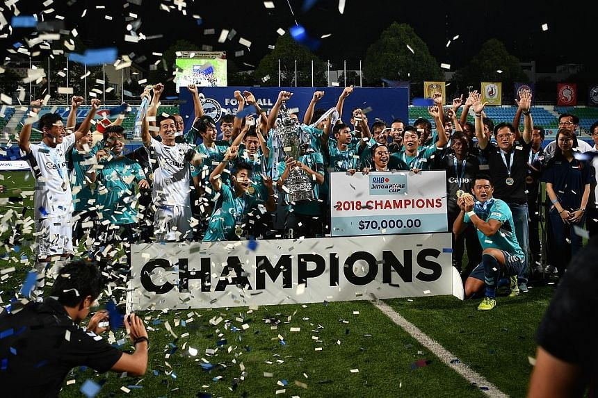 Albirex Niigata celebrating with the RHB Singapore Cup yesterday after beating DPMM. They are the first S-League/SPL team to complete an entire campaign unbeaten.