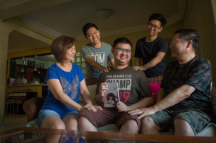 Mr Nigel Ng holding his book Silence Is Not Golden, with his mother Janet Wong, father Frederick Ng and his brothers Norman and Nicholas (with glasses). He attributes his recovery mainly to therapy and a strong support system at home and in secondary