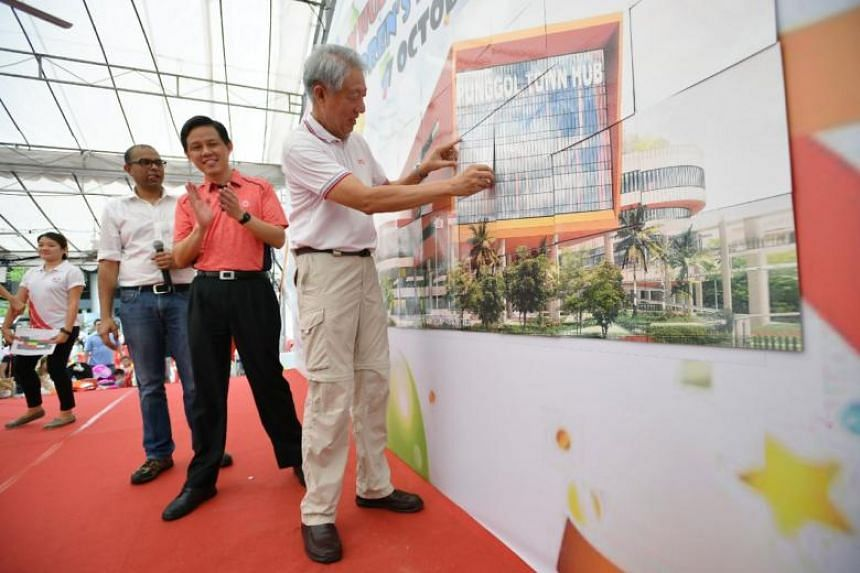 DPM Teo Chee Hean completing the artist's impression of Punggol Town Hub, during the Punggol Town Hub Groundbreaking Ceremony and Children's Day Carnival 2018 at Punggol Town Square, on Oct 7, 2018.