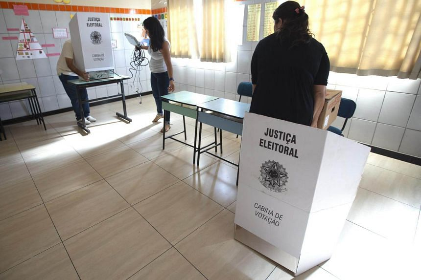Electoral officers set up an electronic voting table in a school in Brasilia, Brazil, on Oct 6, 2018.