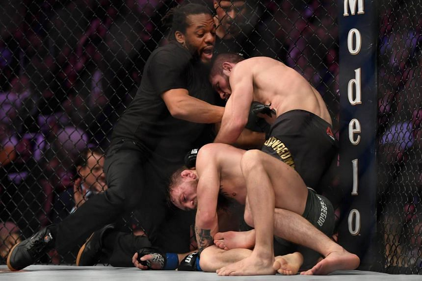 Referee Herb Dean separates Khabib Nurmagomedov from Conor McGregor after McGregor tapped out in their UFC lightweight championship bout, on Oct 6, 2018.