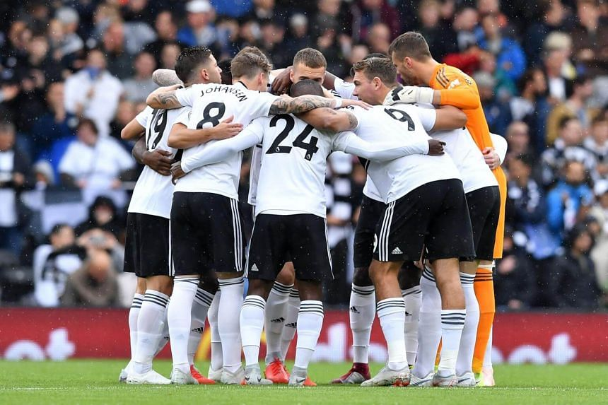 Fulham's players huddle before the English Premier League football match between Fulham and Watford at Craven Cottage in London, on Sept 22, 2018.