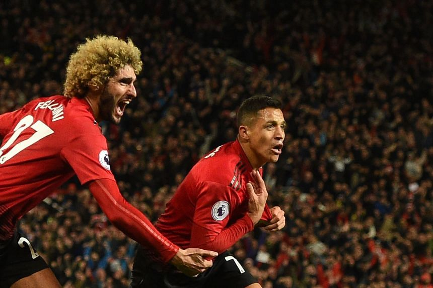 United's Alexis Sanchez (right) celebrates with Marouane Fellaini after scoring the team's third goal.