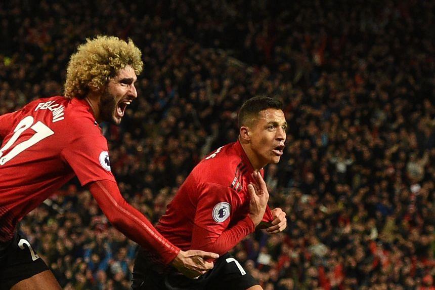 United's Alexis Sanchez (right) celebrates with Marouane Fellaini after scoring the team's third goal.