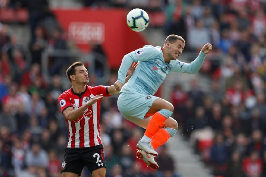 Chelsea's Eden Hazard in action with Southampton's Cedric Soares at St Mary's Stadium, Southampton, Britain, on Oct 7, 2018.