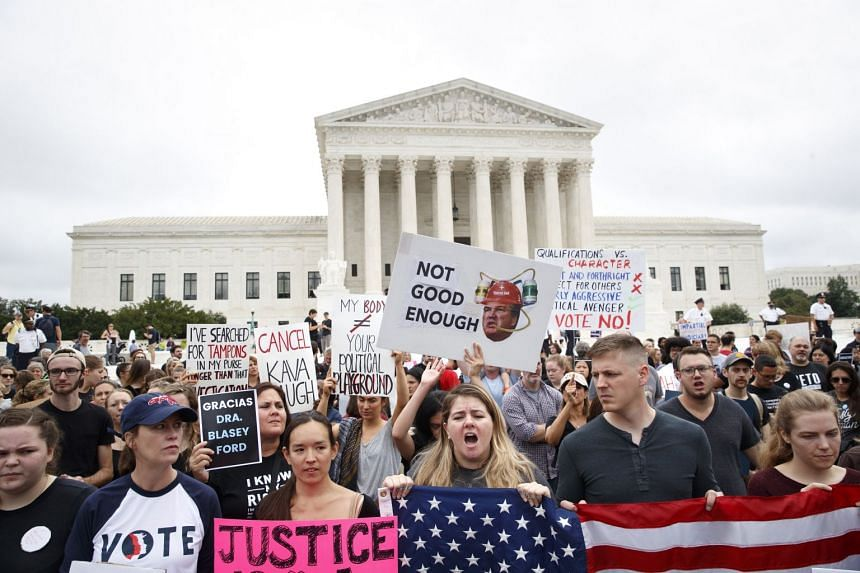 Demonstrators outside the Supreme Court building, on Capitol Hill in Washington, Oct 6, 2018.