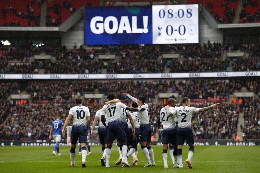 Tottenham Hotspur's English defender Eric Dier celebrates with teammates after scoring.