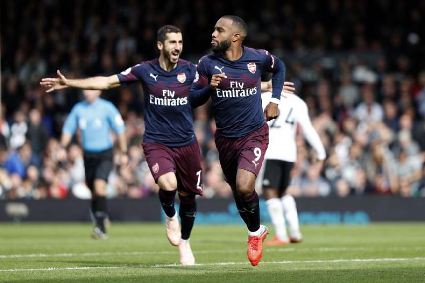 Alexandre Lacazette (right) was at the centre of Arsenal's powerful show at Craven Cottage.