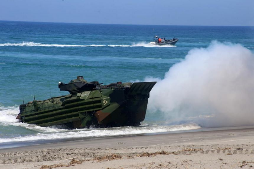 A United States Amphibious Armoured Vehicle takes part in a mock amphibious raid drill, part of the on-going joint US-Philippine Bilateral military exercise in San Antonio, Philippines, on Oct 6, 2018.