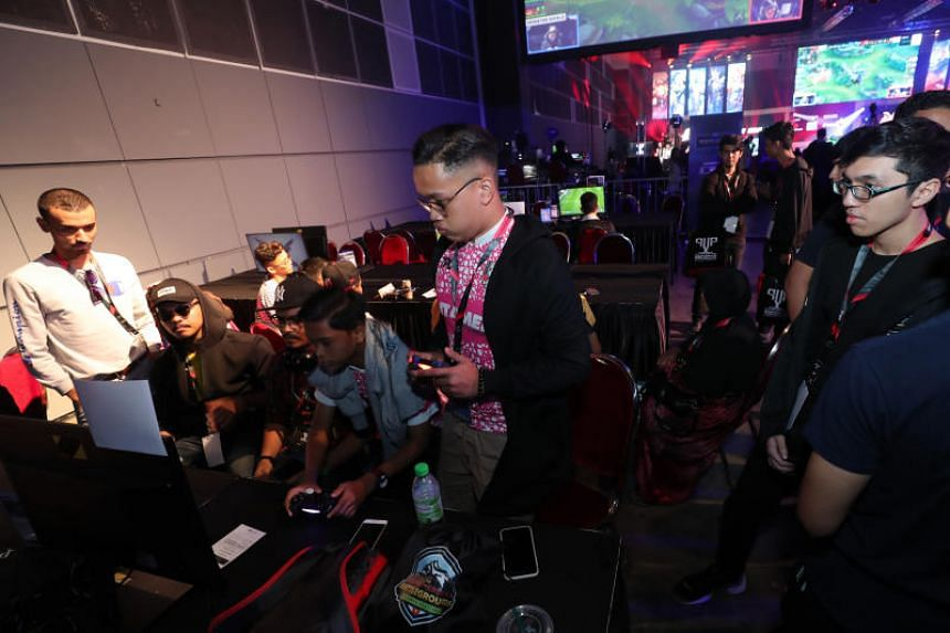Gamers at Singtel's inaugural e-sports competition held at the Suntec Singapore Convention and Exhibition Centre.