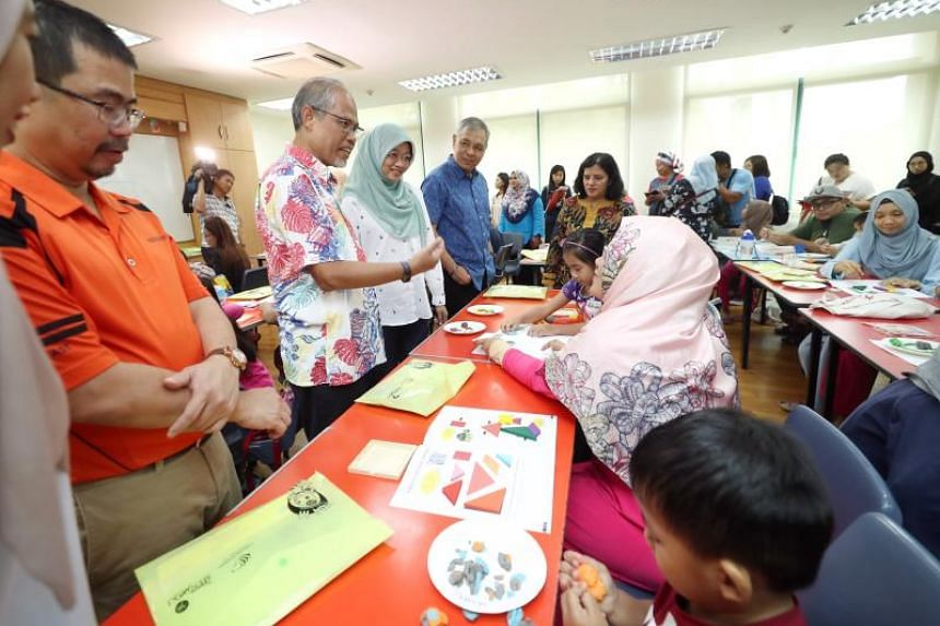 MP Zainal Sapari (in orange) and Minister-in-Charge of Muslim Affairs Masagos Zulkifli (gesturing) at the Malay Cultural Village event at Pasir Ris Elias Community Club, on Oct 7, 2018.