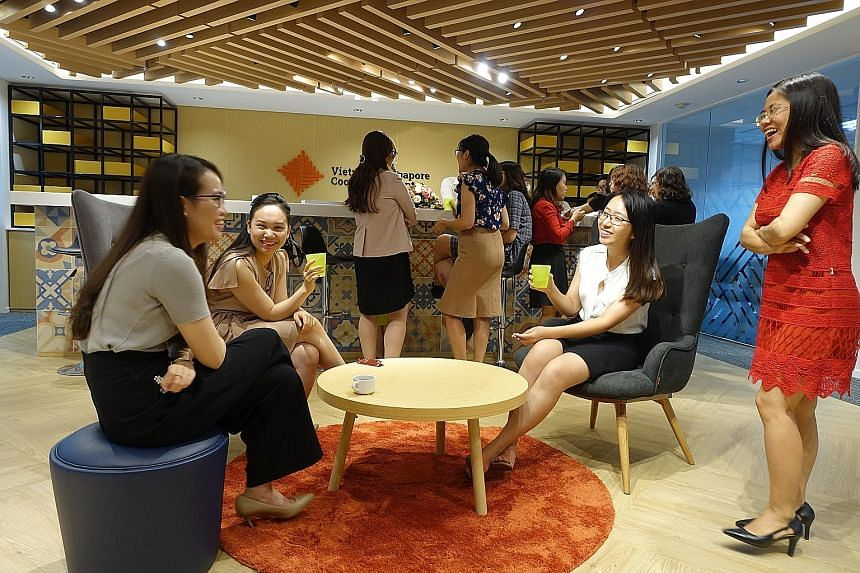 Vietnamese civil servants (left) taking a break during a course at the new Vietnam-Singapore Cooperation Centre in Hanoi last month. Mr Truong Quoc Hung (above) of the Institute for Legislative Studies at the National Assembly Standing Committee said