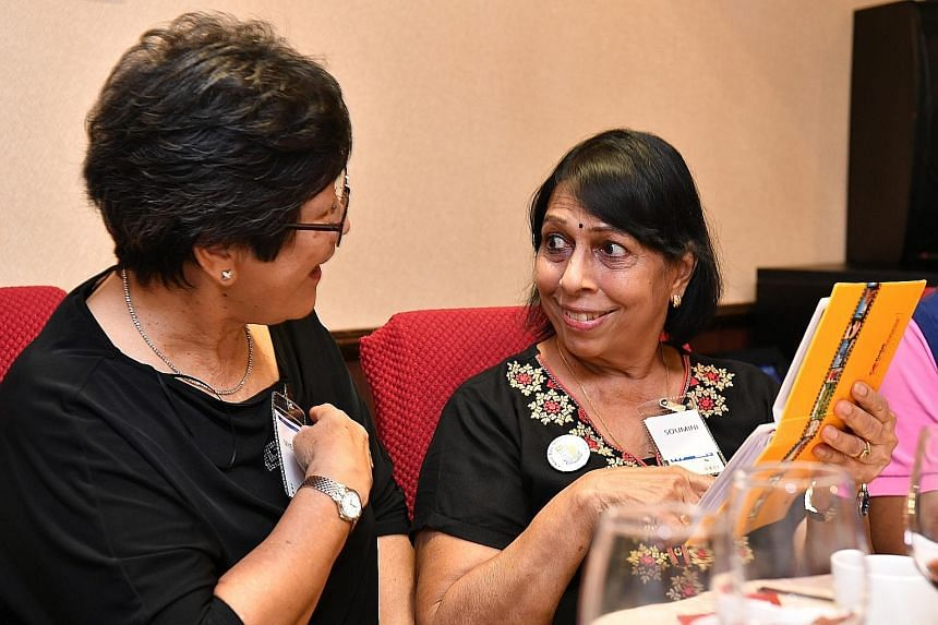 Far left: Ms Soumini Nair and Ms Leow Nyek Koon, 71, looking at old photos during the reunion event last month. Left: (From left) Mr Cramon Chenteley, Ms Amy Mok and Mr Arthur Alvis, all 72, catching up over dinner.