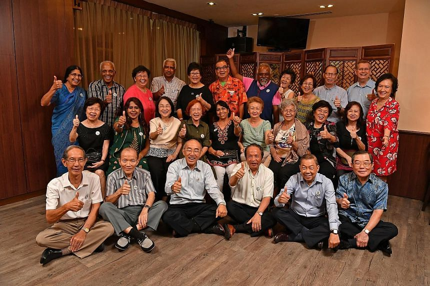 The former schoolmates at Naval Base Secondary School gathered at Square 2 in Novena on Sept 27 for a rare reunion dinner, including Mr Chan Sig Yam (back row, in orange), Mr Yee Kee Seng (back row, third from right), Ms See Lian Kui (middle row, far