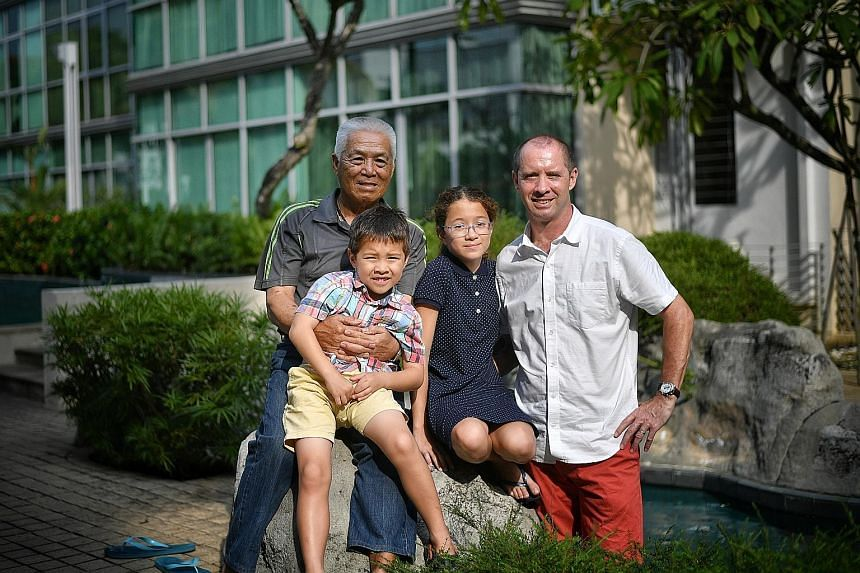 Left: LTC (Ret) Clarence Tan with his son-in-law Thomas Squire and grandchildren Emma and Luke. Above: The book, by Mr Squire, goes on sale next month.