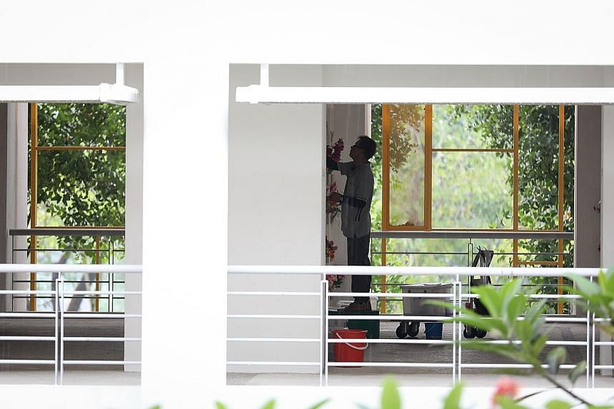 A worker from SLS 518 installing a plaque at Mandai Columbarium late last month. SLS 518 was awarded an NEA tender last year to relocate 20,000 niches at the Mount Vernon Columbarium Complex. The terms required the company to provide marble plaques,