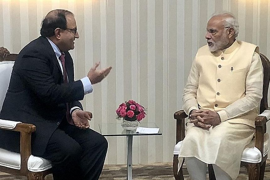 Singapore's Minister-in-charge of Trade Relations S. Iswaran meeting India's Prime Minister Narendra Modi yesterday in Dehradun in the Indian state of Uttarakhand.