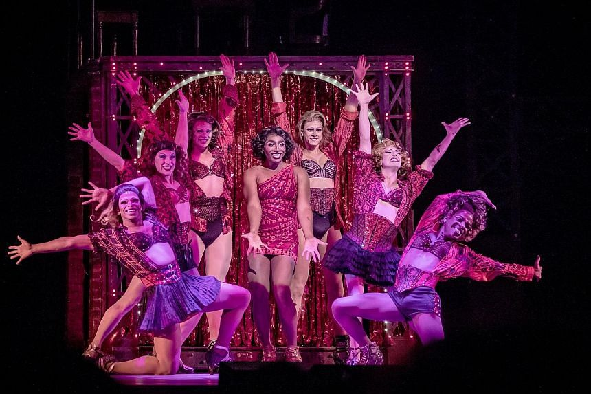 Jos N. Banks (centre) is cabaret performer and drag queen Lola, surrounded by her Angels, in Kinky Boots.